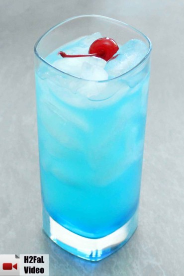 blue lagoon cocktail in front of a grey background