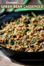 A large black cast iron skillet filled with gourmet green bean casserole.