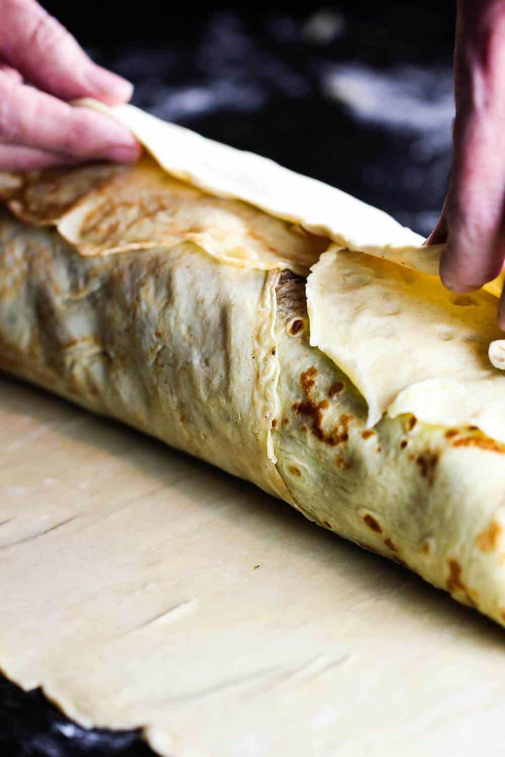 Pastry being wrapped around the classic beef Wellington
