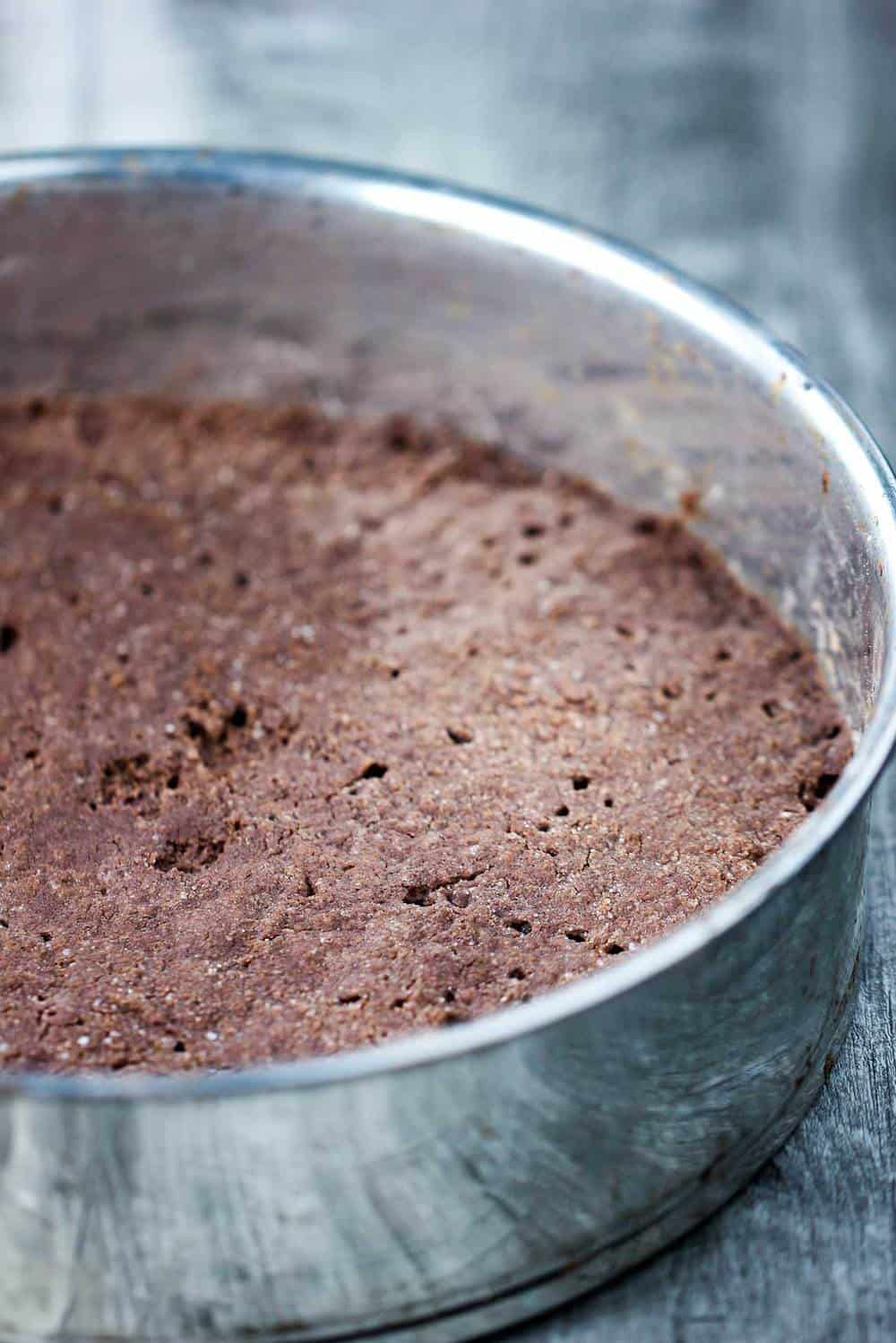 chocolate shortbread crust in a springform pan