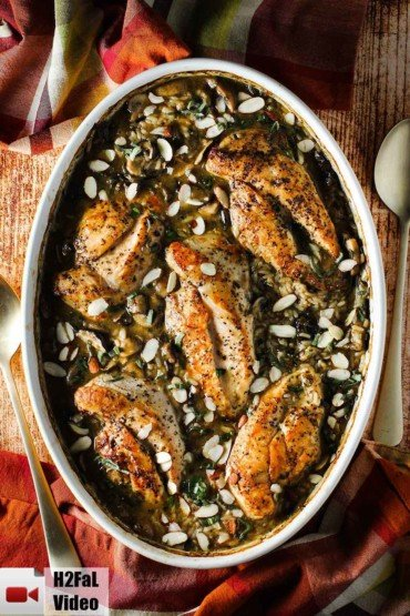 A large oval baking dish of baked chicken and sage casserole.