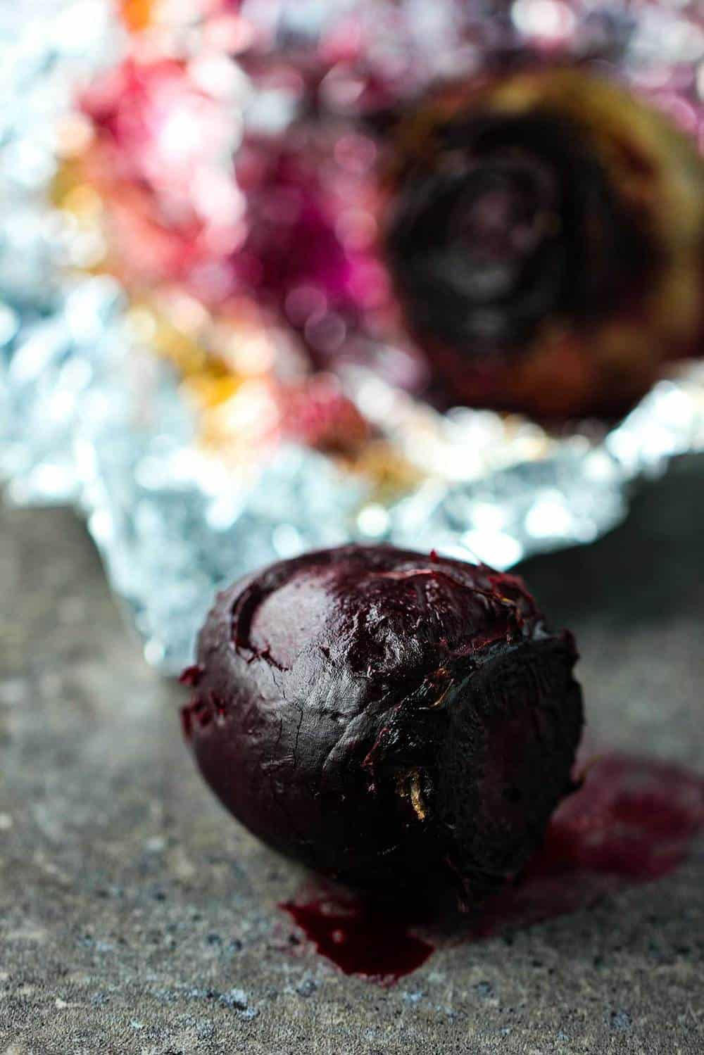 Roasted beet in foil on a counter
