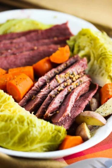 A platter of Instant Pot corned beef and cabbage