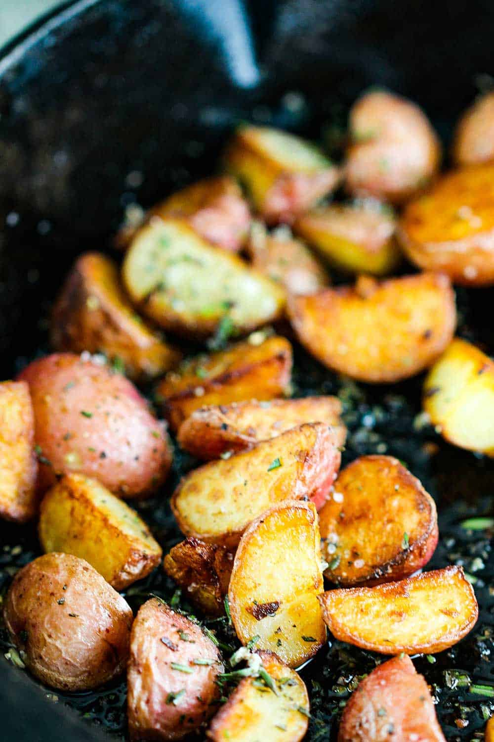 Crispy baby new potatoes in a cast iron skillet