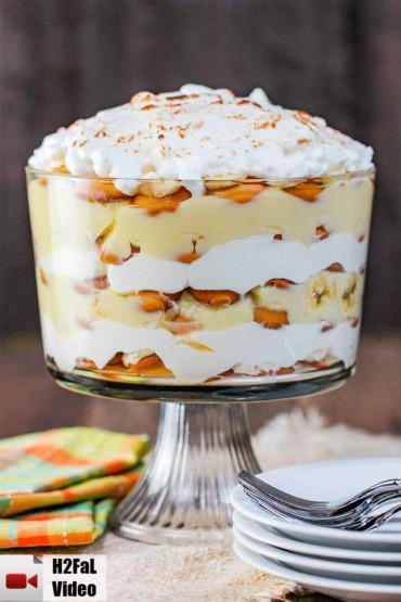 A trifle filled with layers of banana pudding and topped with meringue