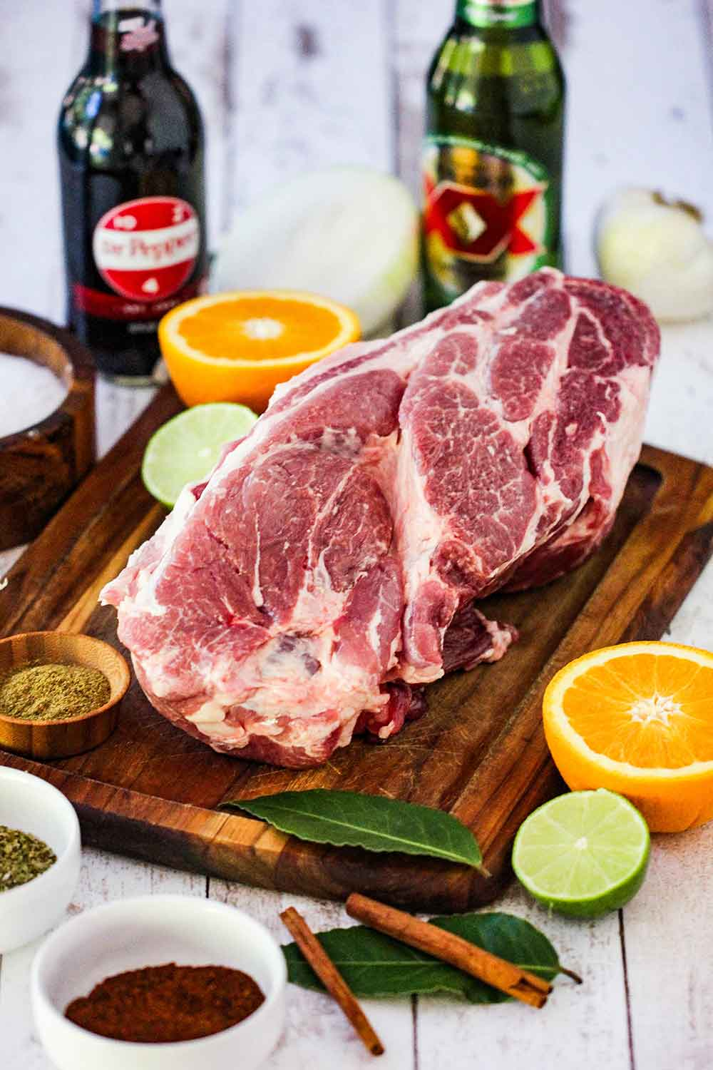 pork shoulder with citrus, herbs, Dr. Pepper and beer are used to slow cook the pork.
