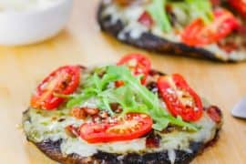 Grilled Portobello BLT Pizzas on a pizza paddle.