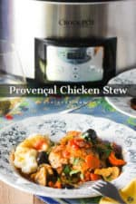A bowl of Provençal Chicken Stew in front of a stainless steel Crock-Pot.