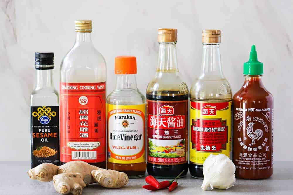 A row of bottles of ingredients for ginger-soy dipping sauce.