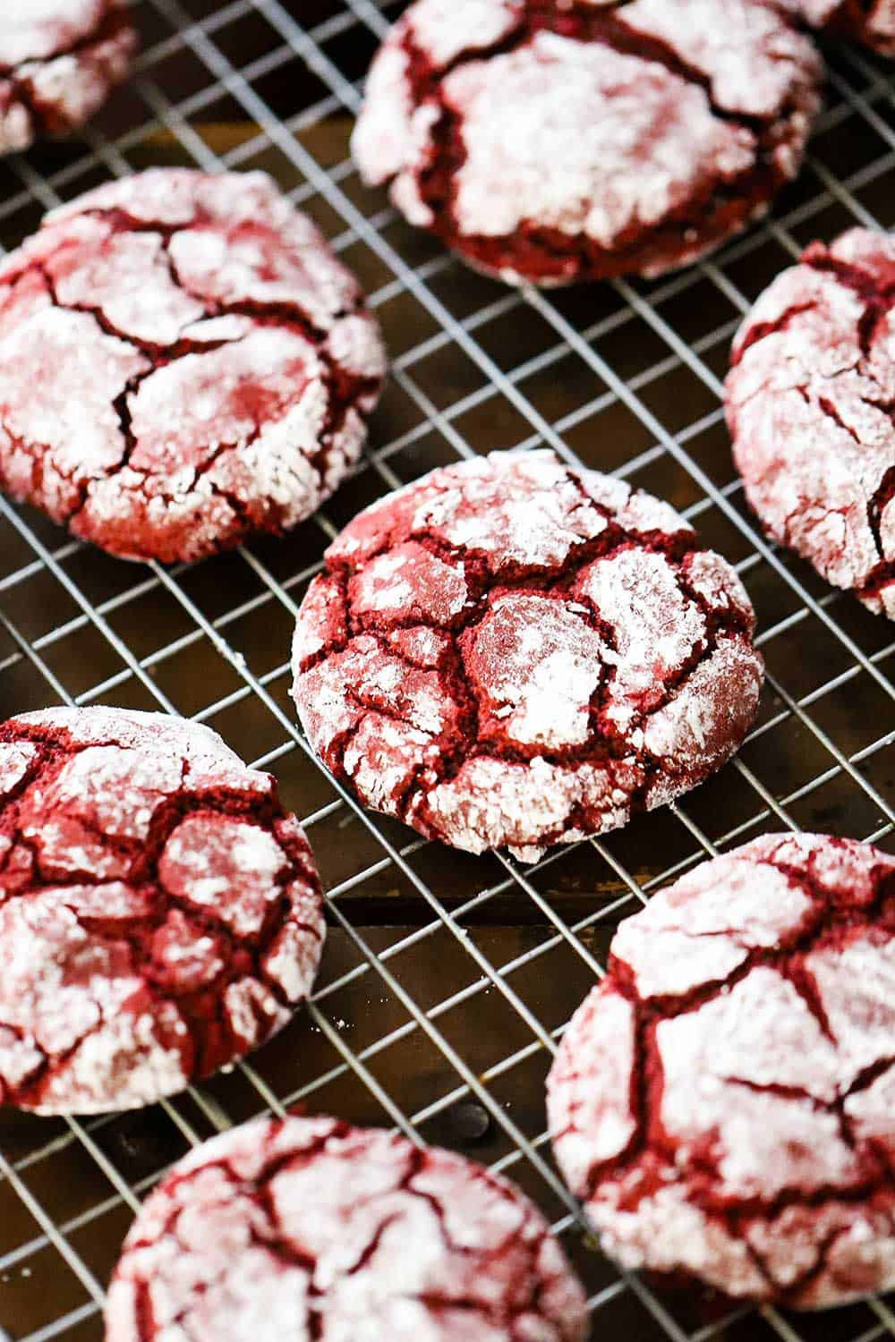 Red velvet cookies cooling on a baking rack.