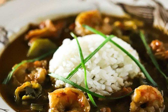 A white bowl filled with shrimp and okra gumbo.
