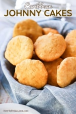A basket lined with a grey napkin and filled with fried Caribbean Johnny Cakes.