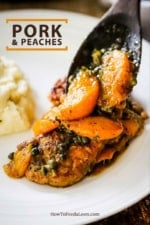 A wooden spoon transferring sautéd peaches and capers onto pan-fried pork cutlets on a white dinner plate.